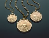 Three Gold Krugerrand Necklaces On Black Plexiglass stock images