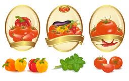 Three gold labels with different vegetables Stock Photo