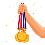 Three gold medals in his hand Royalty Free Stock Images