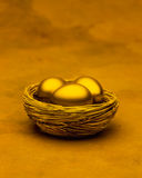 Three Gold Nest Eggs Stock Photos