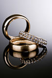 Three gold rings. Royalty Free Stock Photos