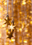 Three gold stars on a yellow Stock Photography