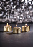 Three golden advent candles lit with bokeh background Stock Photography