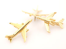 Three Golden Airplanes Royalty Free Stock Image