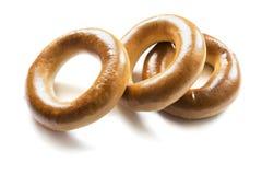 Three golden bagels Stock Photos