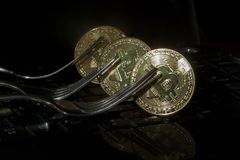 Three golden bitcoins with forks. Cryptocurrency concept Royalty Free Stock Photos