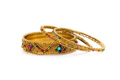 Three golden bracelets Stock Images