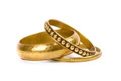 Three golden bracelets Royalty Free Stock Image