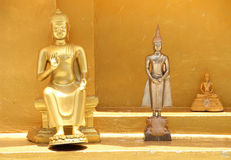 Three golden Buddha statue in three actions Stock Photo