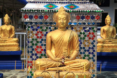 Three golden Buddha statues at Thai temple Stock Photo