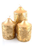 Three golden candles. Isolated on white background Stock Images