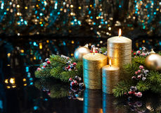 Three golden Candles Stock Photo