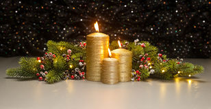 Three golden Candles Stock Image