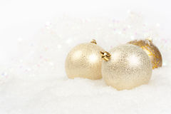 Three golden christmas balls Royalty Free Stock Image