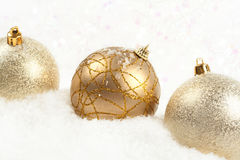 Three golden christmas balls Royalty Free Stock Photo