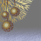 Three golden Christmas balls hanging above the snow surface Royalty Free Stock Images