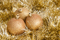 Three golden christmas baubles Royalty Free Stock Image