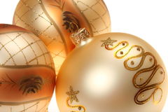 Three golden Christmas baubles Royalty Free Stock Photo