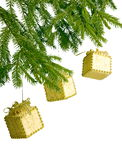 Three golden christmas boxes on fir tr Royalty Free Stock Photos