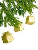 Three Golden Christmas Boxes On Fir Tr Royalty Free Stock Photos