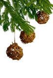 Three golden christmas toys on fir tre Stock Image