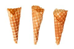 Three golden crispy ice cream waffle cones on white background isolated closeup top view royalty free stock images