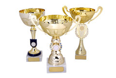 Three golden cups Stock Photos