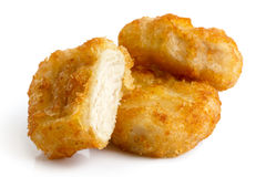 Three golden deep-fried battered chicken nuggets isolated on whi Stock Images