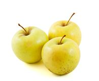 Three Golden delicious apples. Isolated on white background Royalty Free Stock Images