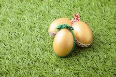 Three golden easter eggs Royalty Free Stock Photos
