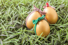 Three golden easter eggs Royalty Free Stock Image