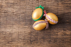 Three golden easter eggs Royalty Free Stock Photography