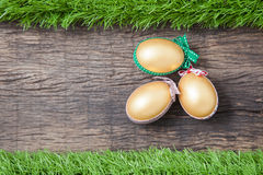 Three golden easter eggs Stock Images
