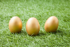 Three golden easter eggs Royalty Free Stock Photo