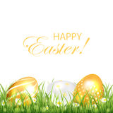 Three golden Easter eggs on white background Stock Images