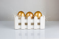 Three golden easter eggs on white background Royalty Free Stock Photography