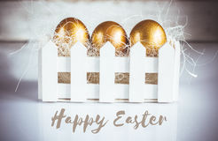Three golden easter eggs on white background Royalty Free Stock Photo