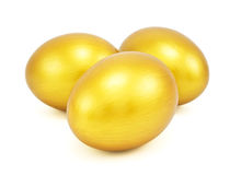 Three golden eggs Stock Image