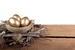 Three golden eggs in a nest Royalty Free Stock Photography