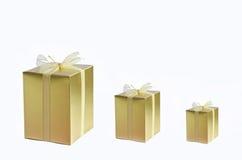 Three golden gift box on white background Stock Image