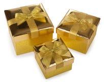 Three golden gift boxes Royalty Free Stock Photo