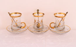 Three Golden Glass Teacups Stock Photography