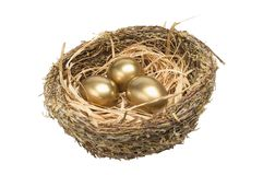 Three golden hen's eggs in the bird's nest Royalty Free Stock Photo