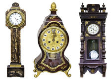 Three golden vintage clocks isolated. Wood Royal Clocks with gold from 18th century Stock Image