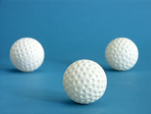 Three golf balls Royalty Free Stock Photos