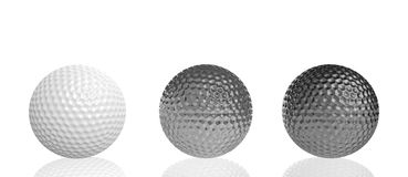 Three golf balls of different materials Stock Photos