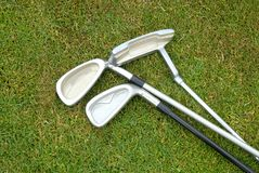 Three golf clubs. On the grass Stock Image