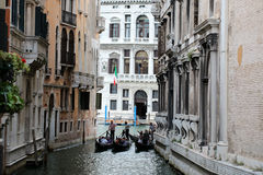 Three gondolas on narrow street Royalty Free Stock Images