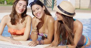 Three gorgeous friendly young women in bikinis stock video footage