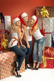 Three gorgeous women in Christmas mood Royalty Free Stock Image
